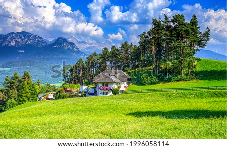 Mountain cabin on the plain. Cottage on mountain hill. Mountain house landscape. Cabin in mountains