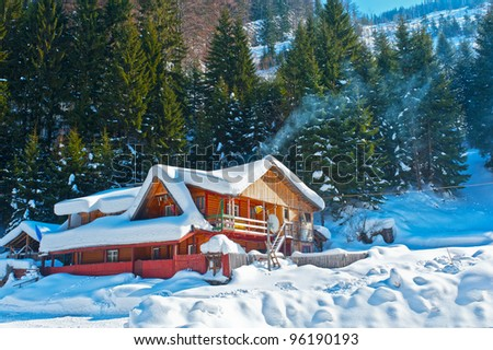 mountain chalet  covered snow  in winter