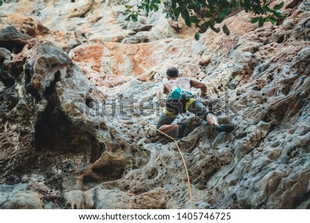 Mountain climber climbing on Climbing Route using rope on Tonsay beach in Krabi, Thailand. #1405746725