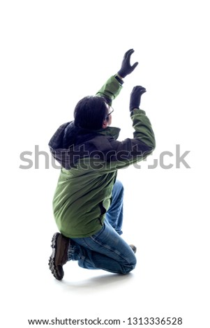 Mountain climber or hiker isolated on a white background for composites.  The man is acting like he is climbing something and depicts adventure and extreme sports.  #1313336528