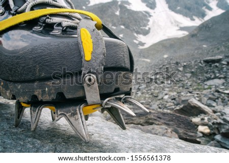 Mountain climbing boot with crampon in alpine landscape. #1556561378