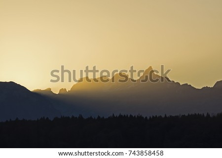 Mountain contours at sunrise #743858458