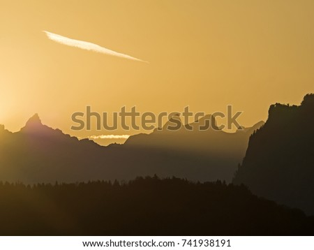 Mountain contours at sunrise, Gebirgskonturen bei Sonnenaufgang #741938191