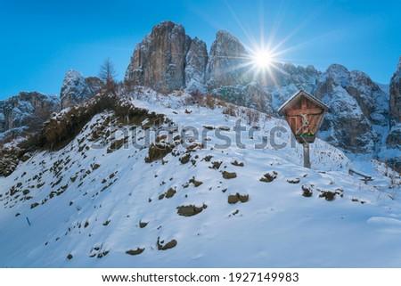 Mountain cross of Gardena mountain pass of Dolomites mountain range o f Italy, Europe, Unesco World Heritage Site