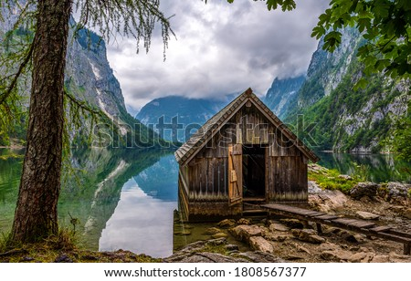 Mountain forest lake house view. Lake house in mountains. Lake house in mountain forest