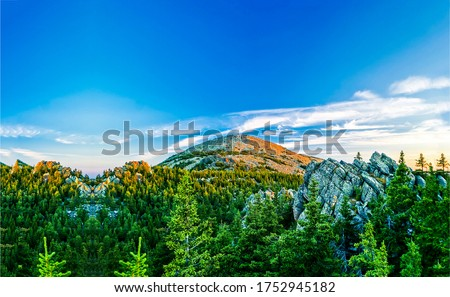 Mountain forest peak blue sky clouds