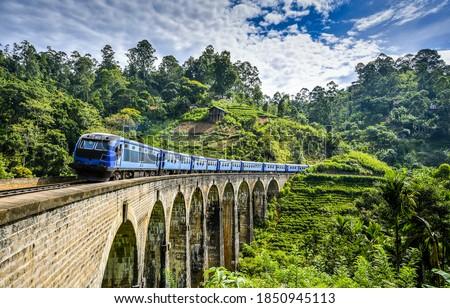 Photo of  Mountain forest railway bridge train ride. Mountain railway bridge train ride. Railway bridge train ride. Train ride on railway bridge