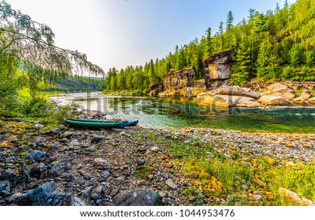 Mountain forest river shore boat landscape #1044953476