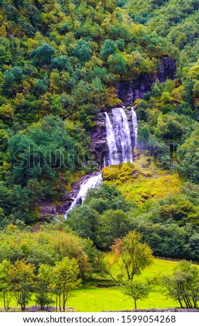 Mountain forest waterfall in autumn