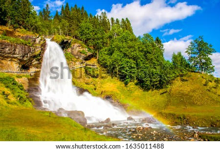 Mountain forest waterfall landscape. Waterfall in mountain forest