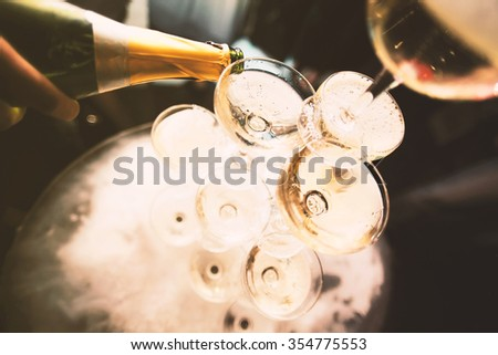 mountain glasses of champagne, a bottle of stream #354775553
