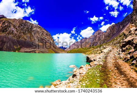 Mountain green lake water landscape. Mountain lake view. Green lake in mountains. Mountain green lake view