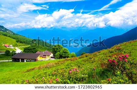 Mountain green valley house landscape. Summer mountain summit house view. Mountain farm house view