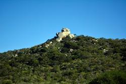 Mountain, green vegetation and tall rocks