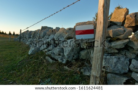 Mountain hiking trail in Switzerland with trail sign