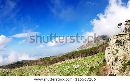 Mountain hill and sky with clouds. Natural composition