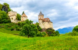 Mountain hill castle view. Castle on hill. Medieval castle landscape