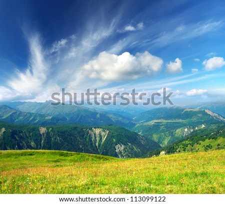 Mountain hills and bright sky with clouds. Summer composition