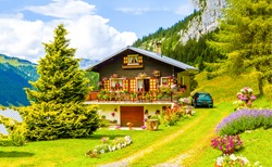 Mountain house garden lodge in summer Bavaria