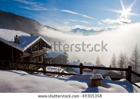 Mountain Hut and snowy landscape