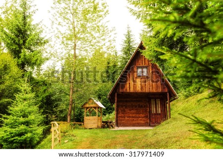 Mountain hut deep inside green forest.