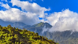 mountain in Indochina landscape terraces green grass blue sky cloud of Tonkinese Alps Sapa, north Vietnam.