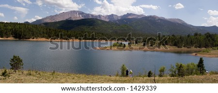 Mountain lake and Pikes Peak panorama - Pikes Peak in the background of a sparkling blue high mountain lake with tourists enjoying the fishing and recreation
