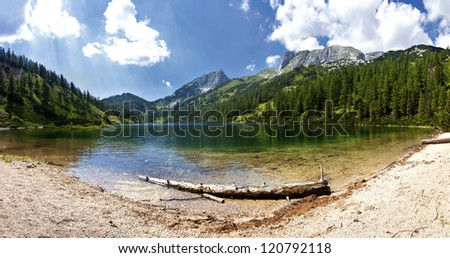 Mountain lake - Austria The Steirersee (1.447m) is a mountain lake of Tauplitzalm/austria and surrounded by natural forest. The mountain range on the right is part of the Toten Gebirge.