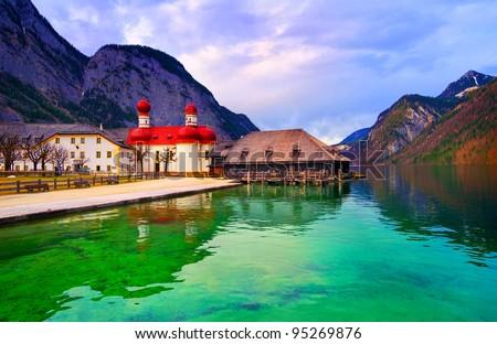Mountain lake Konigsee in german Alps near Munich with St Bartholomew church