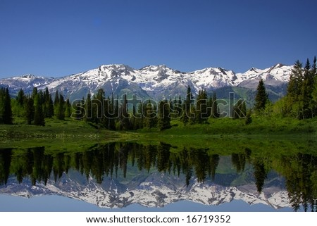 Mountain Lake showing reflections of snow capped mountains