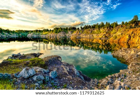 Mountain lake sunset reflection landscape. Sunset lake reflection in mountains. Mountain lake sunset view