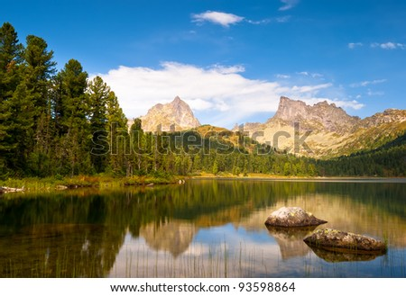 Mountain lake with reflection in park Ergaki, Russia