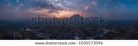 Mountain landscape at sunset. Panorama of beautiful view on hills #1030573096