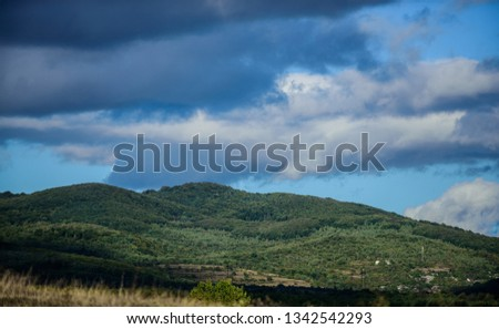 mountain landscape. blue sky with rainy clouds. sunny weather. travel and wanderlust. adventures are waiting for you. hiking camping trip. summer vacation. beauty of nature. adventure is out there. #1342542293