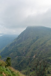 Mountain landscape, green slopes. Beauty of mountains. Little Adam peak, mountain in the fog view from the jungle.