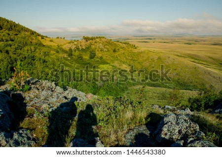 Mountain landscape hills with shadows tourists tourism travel #1446543380