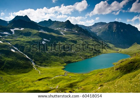 Mountain landscape in green wally with crystal river, in Caucasian mountains.