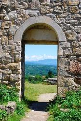 Mountain landscape in monastery's arc