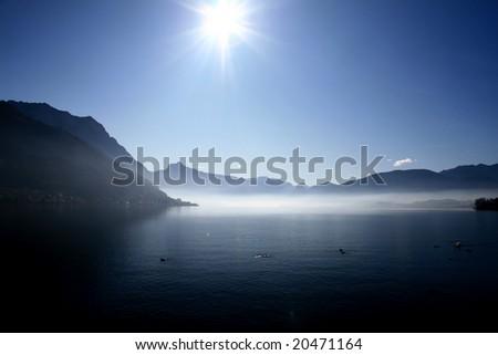 mountain landscape, lake and fog, mist, sun