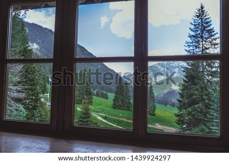 Mountain landscape outside window. Outside view of bright mountains