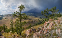 Mountain landscape, stormy sky above the peaks
