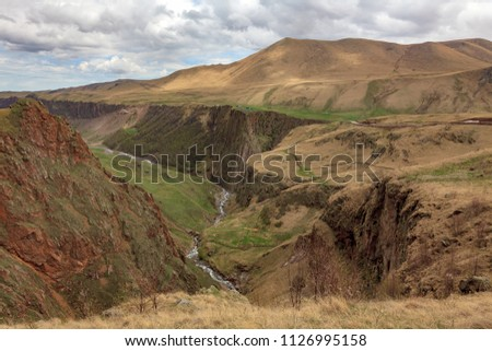 Mountain landscape. The region of Elbrus, Karachay-Cherkessia, Russia. The gorge of the Malka River, the Gyly-Su tract. The place of exit of curative mineral springs and volcanic rocks. #1126995158