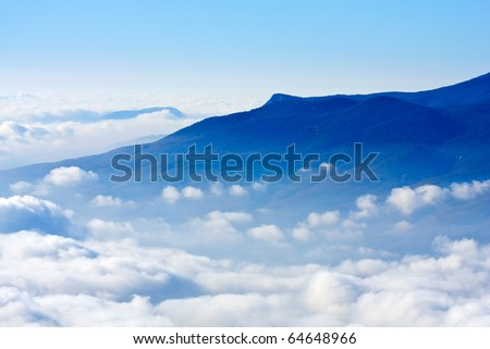 mountain landscape with clouds over hills