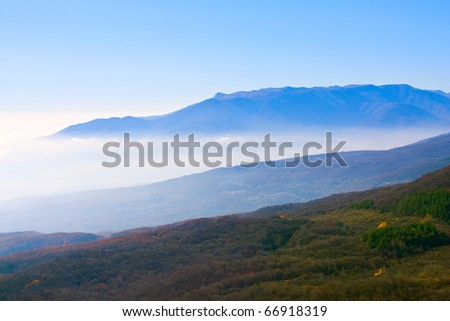 mountain landscape with fog in valley - stock photo
