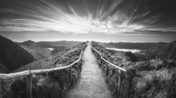 Mountain landscape with hiking trail and view of beautiful lakes Ponta Delgada, Sao Miguel Island, Azores, Portugal. . Black and white concept