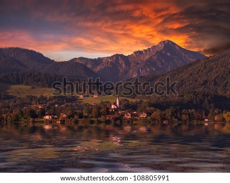 Mountain landscape with majestic sky and reflection in water