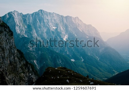 Mountain landscape with Mangart mountain in Julian Alps on the border between Italy and Slovenia #1259607691