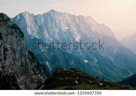 Mountain landscape with Mangart mountain in Julian Alps on the border between Italy and Slovenia #1259607700