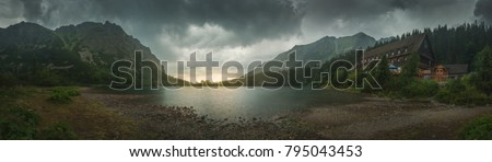 Mountain Landscape with Mountain Chalet at Sunset near Poprad Tarn, High Tatras, Slovakia #795043453