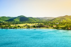 Mountain landscape with small beach at the coastline of Frederiksted, St Croix, US Virgin Islands.